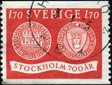 an obverse: SWEDEN - CIRCA 1953  A stamp printed in Sweden honoring 700th Anniversary of Stockholm  Seal of Stockholm, 1296, obverse and reverse, circa 1953  Stock Photo
