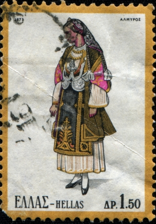 GREECE - CIRCA 1973  A stamp printed in Greece from the  Traditional Greek Costumes 2nd part  issue shows  woman from Almyros, Thessaly, circa 1973 photo