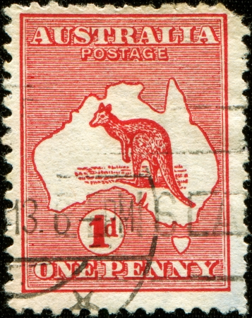 AUSTRALIA - CIRCA 1913  A stamp printed in Australia shows the Kangaroo and Map, circa 1913  photo
