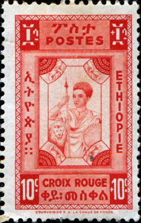 ETHIOPIA - CIRCA 1945  A stamp printed in Ethiopia shows Native soldier, circa 1945 photo