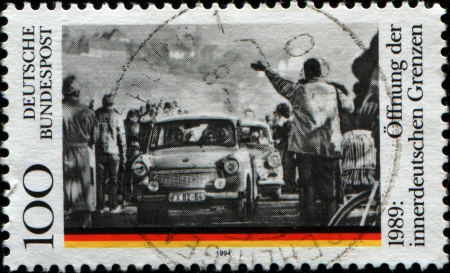 west of germany: GERMANY - CIRCA 1994  A stamp printed in German Federal Republic honoring  5th Anniversary of Opening of Borders between East and West Germany, shows Obersuhl Checkpoint, 11 November 1989, circa 1994