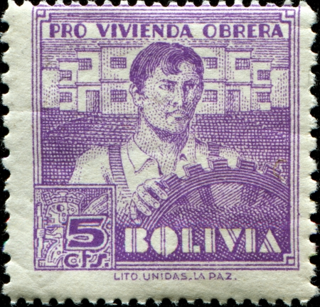 posthorn: BOLIVIA - CIRCA 1939  A stamp printed in Bolivia devoted to housing for the workers, shows worker, circa 1939