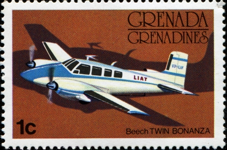 GRENADA - CIRCA 1976  A stamp printed in Grenada showing Beech Twin Bonanza airplane, circa 1976 Stock Photo - 14360134