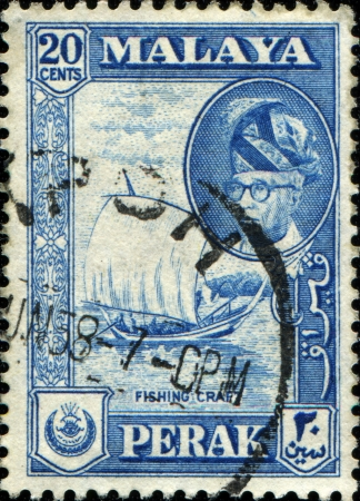malaya: PENANG - CIRCA 1957  A stamp printed in Peneng  Malaya  shows Fishing Craft and inset portrait of Sultan Idris, circa 1957