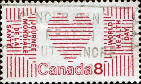 CANADA- CIRCA 1972  A stamp printed in Canada honoring World Health Day shows Heart and World Health Organization Emblem, circa 1972