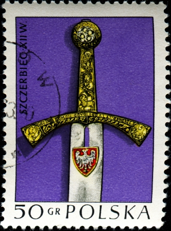 postmail: POLAND - CIRCA 1973  A stamp printed in Poland shows handle of the sword 17 century, circa 1973  Stock Photo