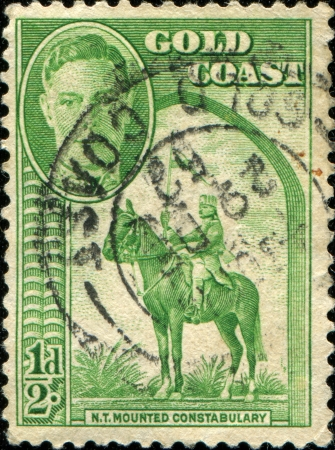 constabulary: GOLD COAST - CIRCA 1948  A stamp printed in Gold Coast honoring Northern Territories Mounted Constabulary shows Horse Riding, circa 1948  Stock Photo