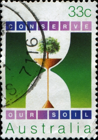 AUSTRALIA - CIRCA 1985  A stamp printed in Australia shows Tree, and Soil running through Hourglass, circa 1985 photo