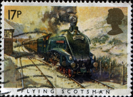 GREAT BRITAIN - CIRCA 1985  A stamp printed in the Great Britain shows Flying Scotsman locomotive, Sesquicentennial of Great Western Railroad, circa 1985  photo