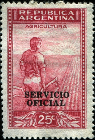 ARGENTINA - CIRCA 1938  A stamp printed in Argentina, shows a farmer in front of the plowed field, circa 1938 Stock Photo - 14407689