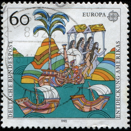 fleet: GERMANY - CIRCA 1992  A stamp printed in Germany, is dedicated to the 500th anniversary of the discovery of America, shows the arrival of the fleet of Columbus,  Woodcut, 1493 , circa 1992  Stock Photo