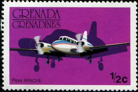 GRENADINES OF GRENADA - CIRCA 1976  A stamp printed in Grenadines of Grenada shows Piper Apache airplane, circa 1976 Stock Photo - 14407684