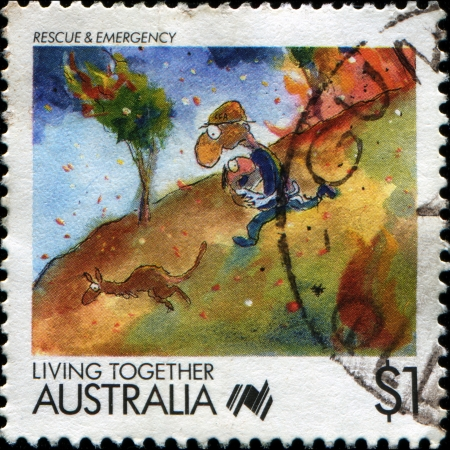 AUSTRALIA - CIRCA 1988  A stamp printed in Australia shows Living Together cartoons Rescue and Emergency, circa 1988  photo