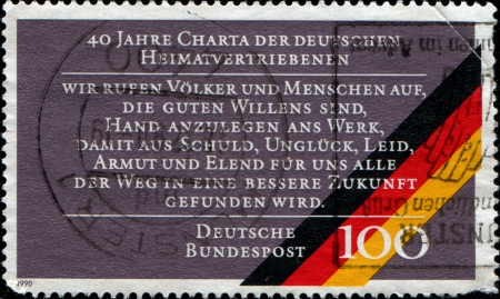 GERMANY - CIRCA 1990  A stamp printed in Germany, dedicated to 40th anniversary of the Charter of German Expellees, circa 1990 Stock Photo - 14436774