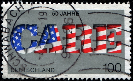 GERMANY- CIRCA 1995  A stamp printed by Germany, shows text care 50th anniversary,care in American Colours, circa 1995   photo