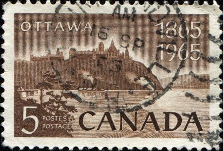 CANADA - CIRCA 1965  A stamp printed by Canada shows Parliament and Ottawa River, circa 1965 Stock Photo - 14472496
