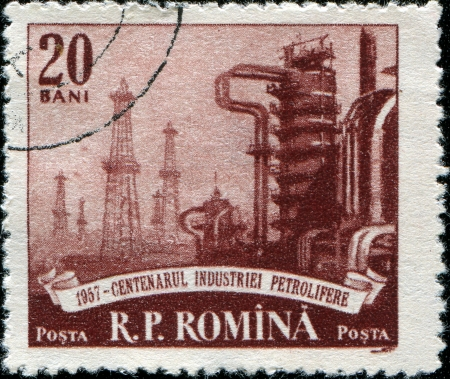 ROUMANIA - CIRCA 1953  A stamp printed in Roumania shows  petroleum plant, series, circa 1953  photo
