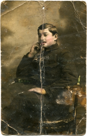 paramilitary: hand-painted portrait of a young man in paramilitary uniforms, sitting in a chair, USSR, 1920s