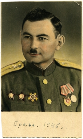 hand-painted portrait of an artillery colonel of the Soviet Army, awarded the Order of the Great Patriotic War, two Orders of Red Star and two medals, Prague, Czechoslovakia, 1945, the Russian text - Prague