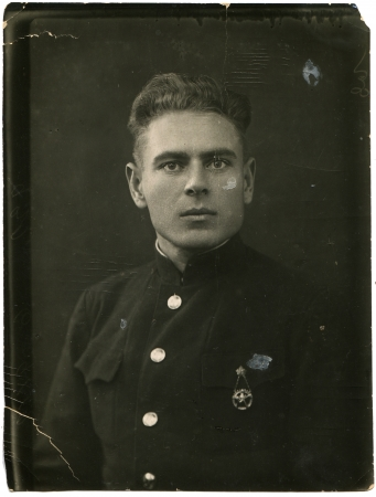 USSR - CIRCA 1938  A young man with a sports badge on his chest, circa 1938