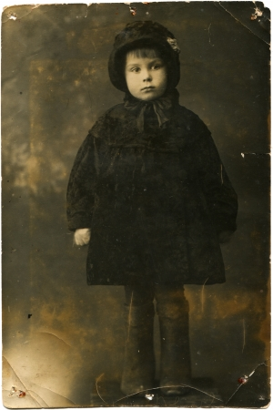 elan: USSR - CIRCA 1940  Studio portrait of little girl with a coat, hat and boots, Elan, Volgograd Region, Russia, circa January 1940, the girl