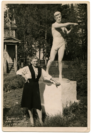 USSR - CIRCA 1951  Portrait of a young woman near the monument discus thrower, Vyritsa, Gatchina district, Leningrad region, circa 1951, the Russian text - Vyritsa, holiday home