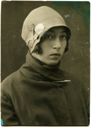 USSR - CIRCA 1928  Portrait of a young woman in a coat and hat, circa 1928