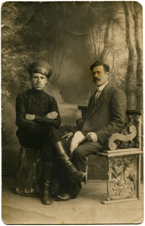 RUSSIAN EMPIRE - circa 1910s  Reproduction of picture was made in the Russia shows cabinet portrait of the Cossack and civil man, circa 1910s