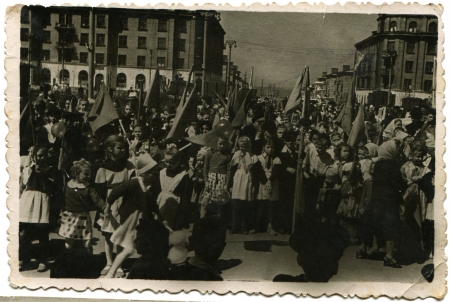 pioneers: USSR - CIRCA 1950s  Reproduction of picture was taking in USSR shows the pioneers during the May Day demonstration, Lugansk, Ukraine, circa 1950s Editorial