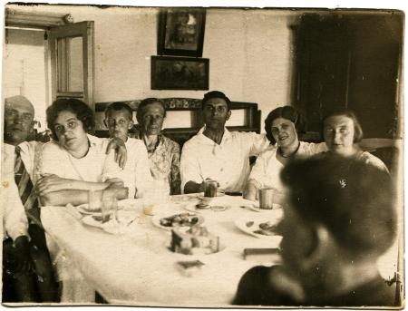 old photograph: USSR - CIRCA 1936  Family Feast, circa 1936