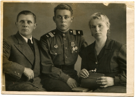 awarded: USSR - CIRCA 1940s  Cabinet picture of the family Sergeant armored forces of the Soviet Army, awarded medals, circa 1940s