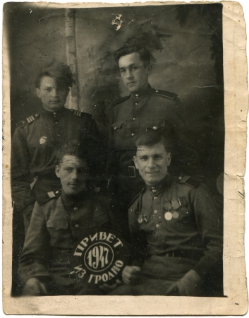USSR - CIRCA 1947  Cabinet pictures three Guard sergeants and soldier of the Soviet Army, Grodno, Belarus, 1947