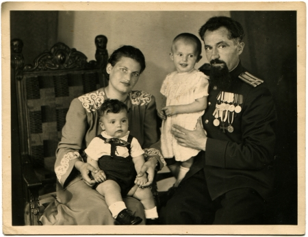awarded: USSR - CIRCA 1947  Cabinet picture of the family of colonel of the Soviet Army, awarded orders and medals, circa 1947