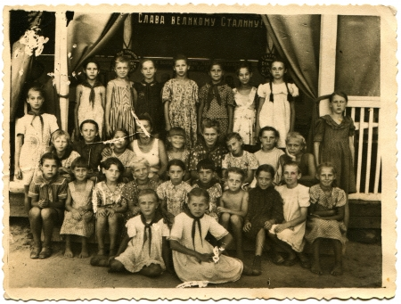 USSR - CIRCA 1951  Children rest in pioneer camp Merry Mount, Lugansk region, circa 1951, the Russian text - Glory to the great Stalin Stock Photo - 14499783