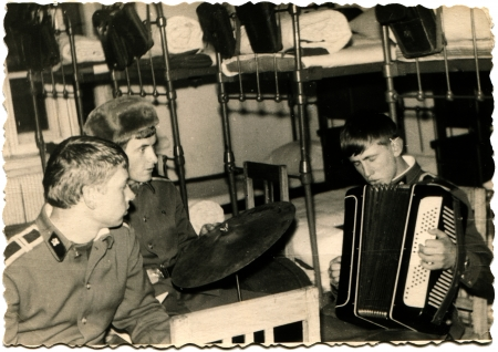 rehearse: USSR - CIRCA 1960s  amateur orchestra Voroshilovgrad Military School cadets navigators rehearse in the barracks, Voroshilovgrad now Lugansk, Ukraine, circa 1960s