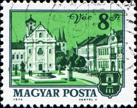 HUNGARY - CIRCA 1974  A stamp printed in Hungary shows Church and city hall, Vac, circa 1974  Stock Photo - 14520532
