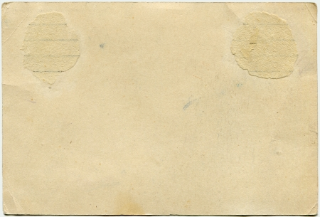 yellowed paper of back side of postcard