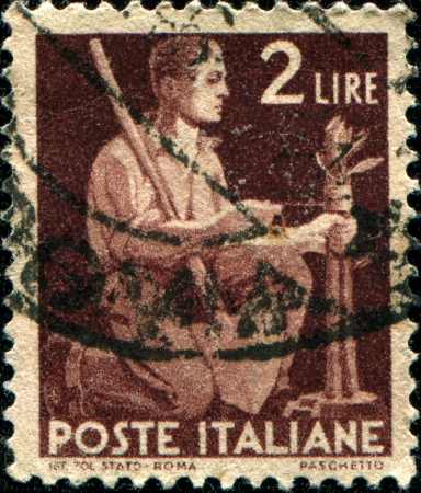 ITALY - CIRCA 1953  A stamp printed in Italy shows a man kneeling, series, circa 1953  Stock Photo - 14520557
