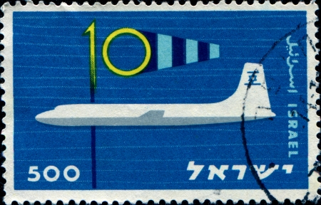 ISRAEL - CIRCA 1959  A post stampprinted in Isarael issued in honor of the 10th Anniversary of Civil aviation in Israel, series, circa 1959  Stock Photo - 14520508