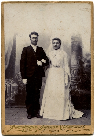 RUSSIA - CIRCA end of the XIX - the beginning of XX century  An antique photo shows bride and groom, the village Petropavlovsk now SeverouroalskRussian text  photography studio Russian light painting