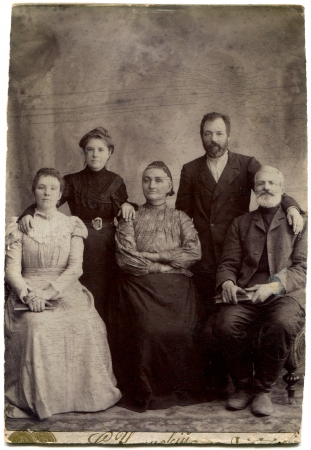 two generation family: RUSSIA - CIRCA end of the XIX - the beginning of XX century  An antique photo shows family of five persons in two generations, Lugansk, Russian Empire, UkraineRussian text  Umanskiy  name of photographer , Lugansk