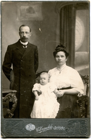 RUSSIA - CIRCA end of the XIX - the beginning of XX century  An antique photo shows family with one child, Lugansk, Russian Empire, UkraineRussian text  Umanskiy  name of photographer , Lugansk Editorial