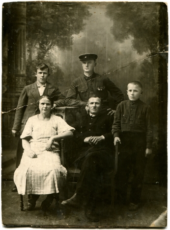 black and white photograph: USSR - CIRCA 1930s  An antique photo shows family, USSR, 1930s