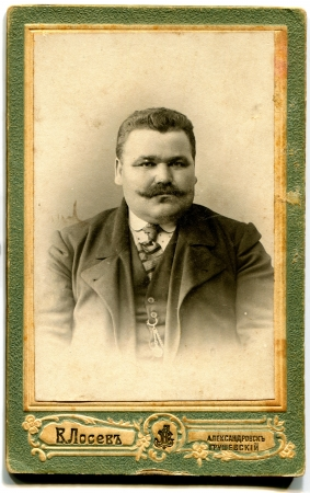 RUSSIA - CIRCA 1915  fat man with a mustache, Aleksandrovsk-Hrushevsky, now the city of Shakhty, the Rostov Region, the Russian Empire, 1915 Russian text  Locev  name of ohotographer , Aleksandrovsk-Hrushevsky