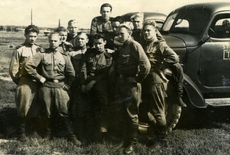 USSR - CIRCA 1958  Postcard shows group of Soviet soldiers against the truck, USSR, 1958