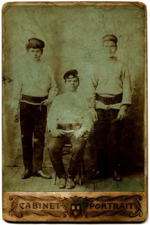 xx century: RUSSIA - CIRCA end of the XIX - the beginning of XX century  three boys in service caps, the Russian Empire, end of the XIX - the beginning of XX century