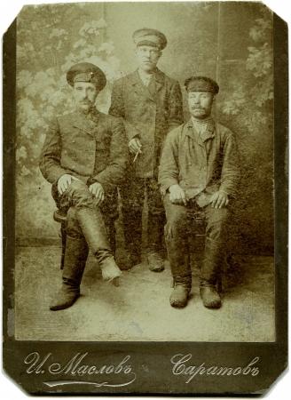 xx century: RUSSIA - CIRCA end of the XIX - the beginning of XX century  Three railway workers, Saratov, Russian EmpireRussian text  Maslov  name of photographer , Saratov