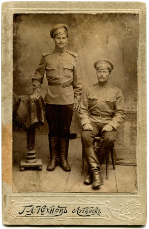 lugansk: RUSSIA - CIRCA period of World War I  two soldiers, Lugansk, Russian Empire, now UkraineRussian text  Yukhnow  name of photographer , Lugansk Editorial
