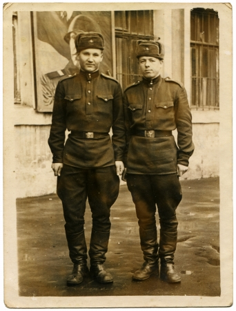USSR - CIRCA 1959  Postcard shows Two Soviet soldiers against the barracks, of the USSR, 1959