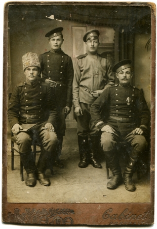 RUSSIA - CIRCA period of the First World War  An antique photo shows four soldiers, the Russian Empire